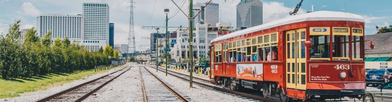 An iconic New Orleans streetcar heading towards the city.