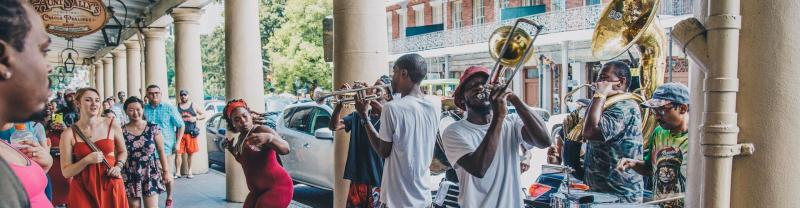 A traditional, street jazz band playing live music in the streets of New Orleans.