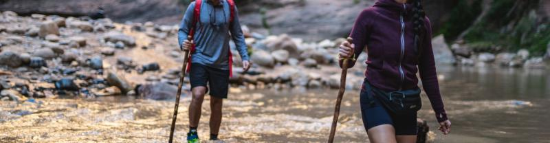 Two hikers in The Narrows in Zion National Park