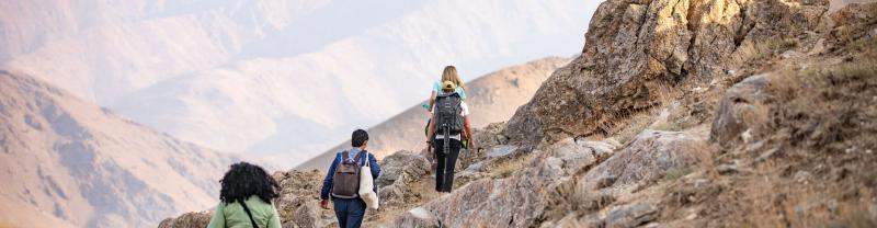 Travellers hiking through Nuratau Mountains, Uzbekistan