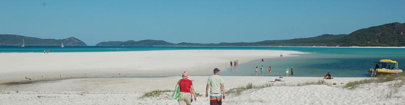 People walking on a beach in the Whitsundays, Queensland