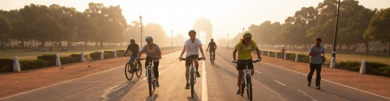 Travellers cycling in Rajasthan, India, at sunrise.