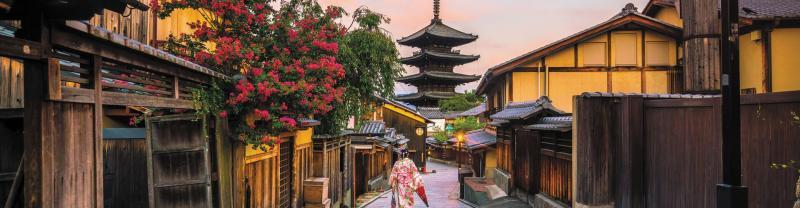 Traveller walking down street, Kyoto Japan