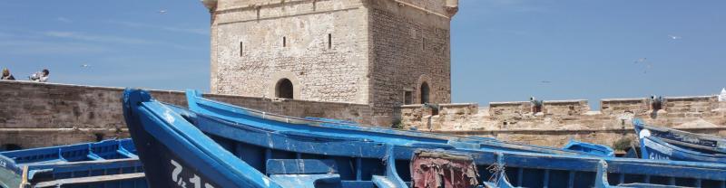 Blue boat moored in Essaouira, Morocco