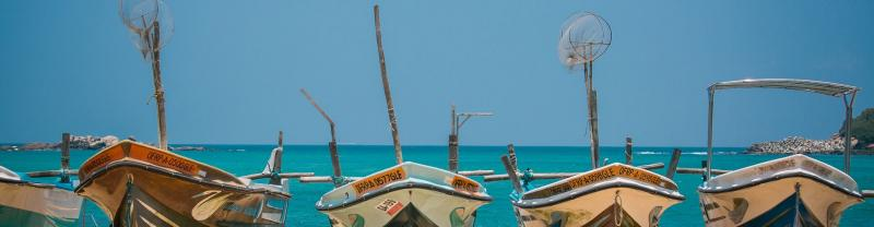Boats lined up along Unawatuna Beach in Sri Lanka