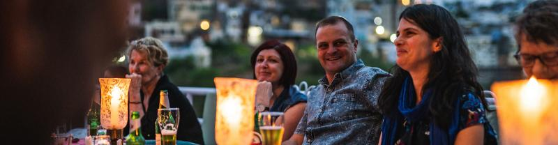 Intrepid Premium travellers enjoying a rooftop dinner in India