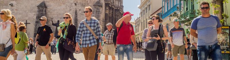 A local leader takes his group through the streets of Cuba.