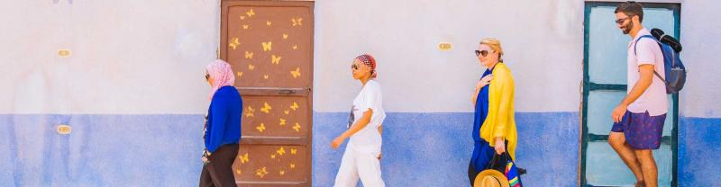 Travellers wander the colourful streets of Egypt
