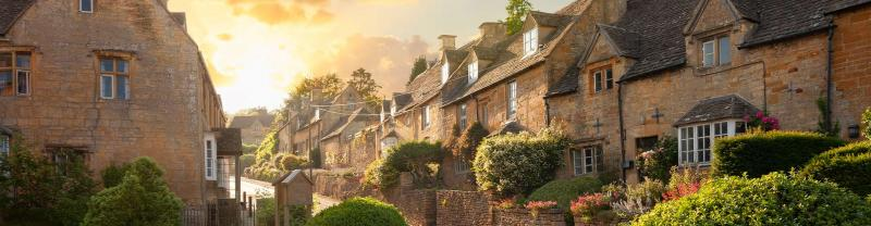 The sun setting over a village in the Cotswolds.