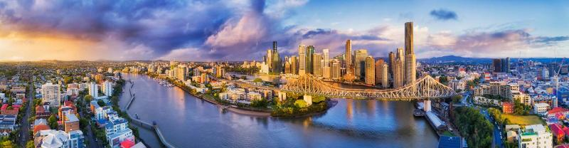 A panoramic view of Brisbane's cityscape at sunset.