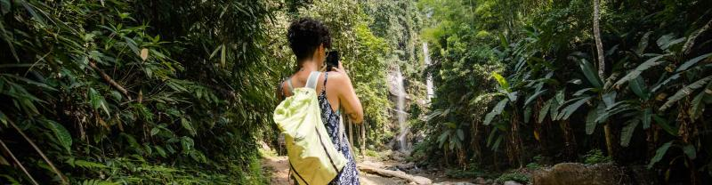 Traveller takes photo in cambodian jungle
