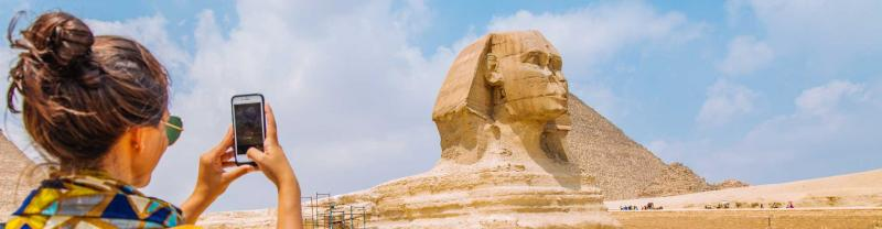 traveller takes photo of sphinx in Giza