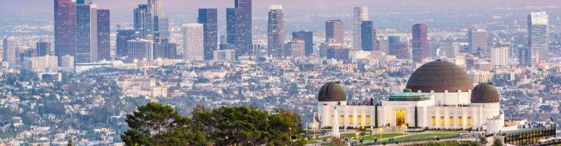 Aerial view of the Griffith Park Observatory with downtown Los Angeles in the background