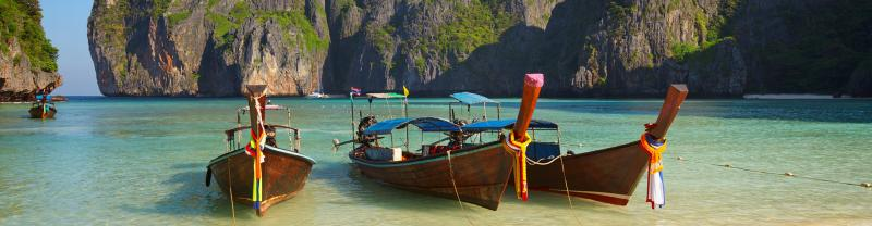 Long boats at a beach in Thailand