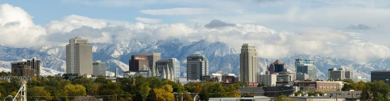 A panoramic view of Salt Lake City with the Wasatch Mountains in the distance.