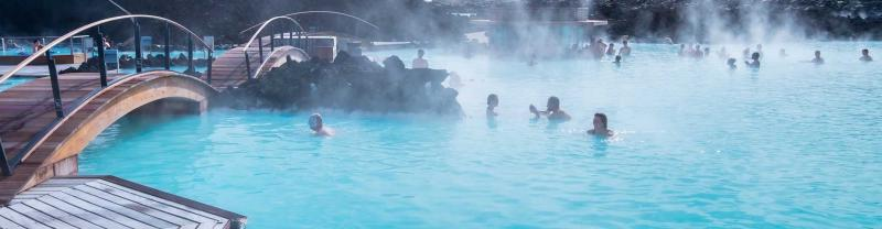 Travellers swim in the geothermal blue lagoon, Iceland