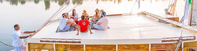 Travellers on a felucca cruise along the Nile