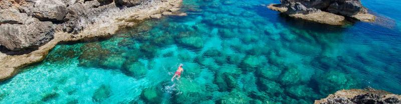 Traveller goes for swim in the waters of ayia napa, cyprus