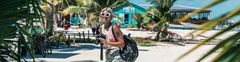 Traveller takes photos on beach in belize