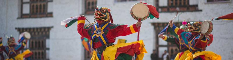Colourful Mongar monks perform a traditional dance in Bhutan