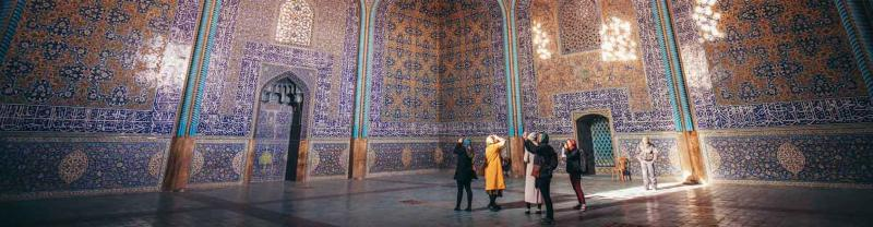 Travellers gaze at the detail of Sheikh Lotfollah Mosque, Esfahan, Iran