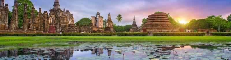 Sunset at Sukhothai ancient ruins lake and temples