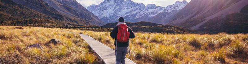 Traveller walking in Hooker Valley, New Zealand