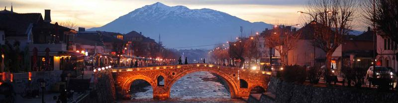 Bridge over water with mountain in background at dusk in Prizren, Kosovo