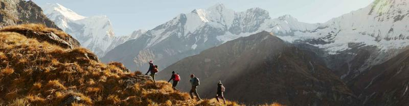 Hikers make their way up mountain range in Annapurna