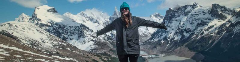 Woman standing in front of glaciers in Patagonia