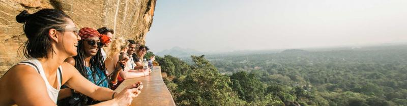 Group of travellers look out over Sigiriya lion rock fortress