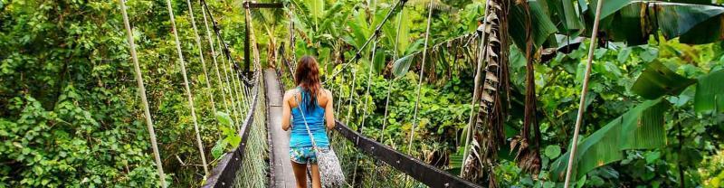 Traveller walking on the Lavena Coastal Walk, Taveuni Island, Fiji