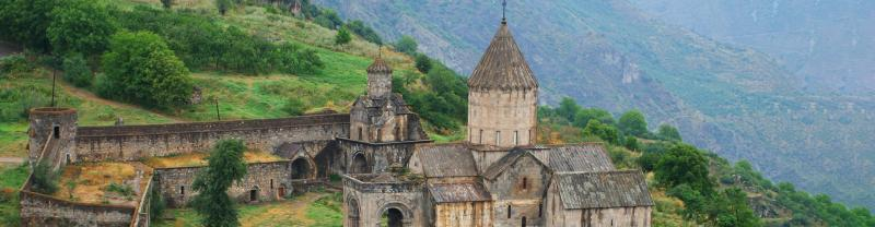 The medieval Tatev Monastery sits atop a green hill in Goris, Armenia