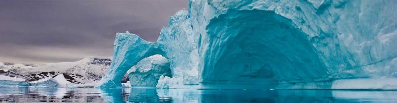 Giant iceberg on the coastline of Greenland before sunrise