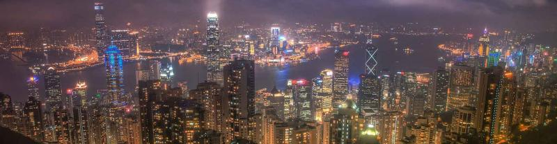 Panorama of Hong Kong at night with bright city lights