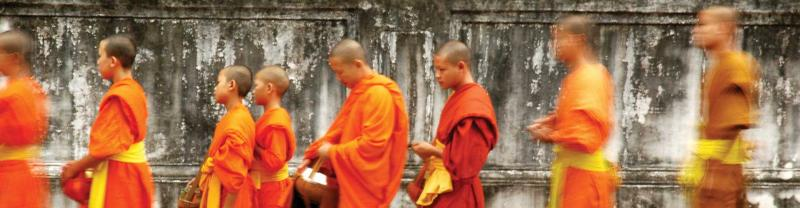 Young monks in a line during Alms giving ceremony in Luang Prabang, Laos