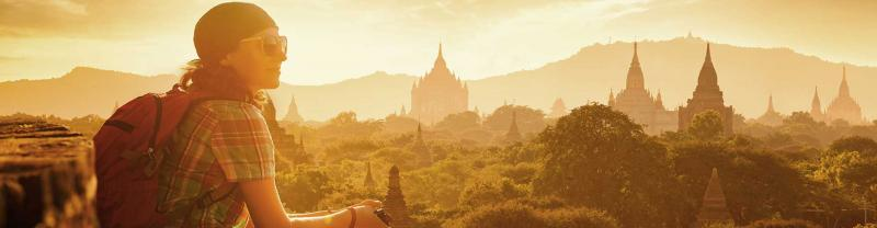 Woman enjoying sunset view over temples in Bagan, Myanmar