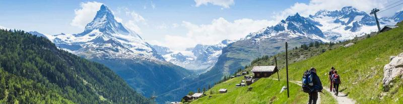 Travellers hike through the swiss alps