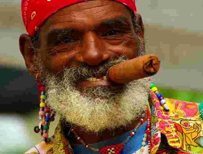615181d2cbd Cuban man smoking a cigar