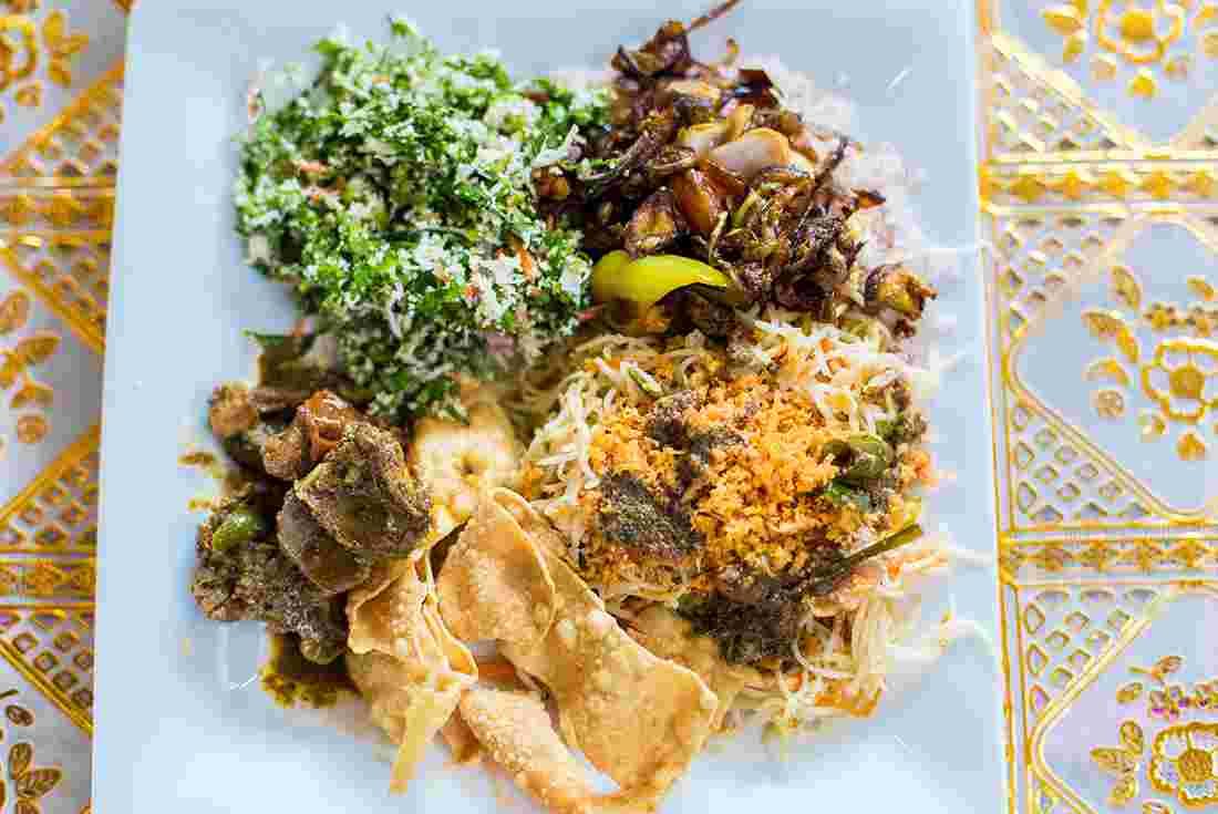 Sri lanka real food adventure intrepid travel traditional plate of food from sri lanka forumfinder Images