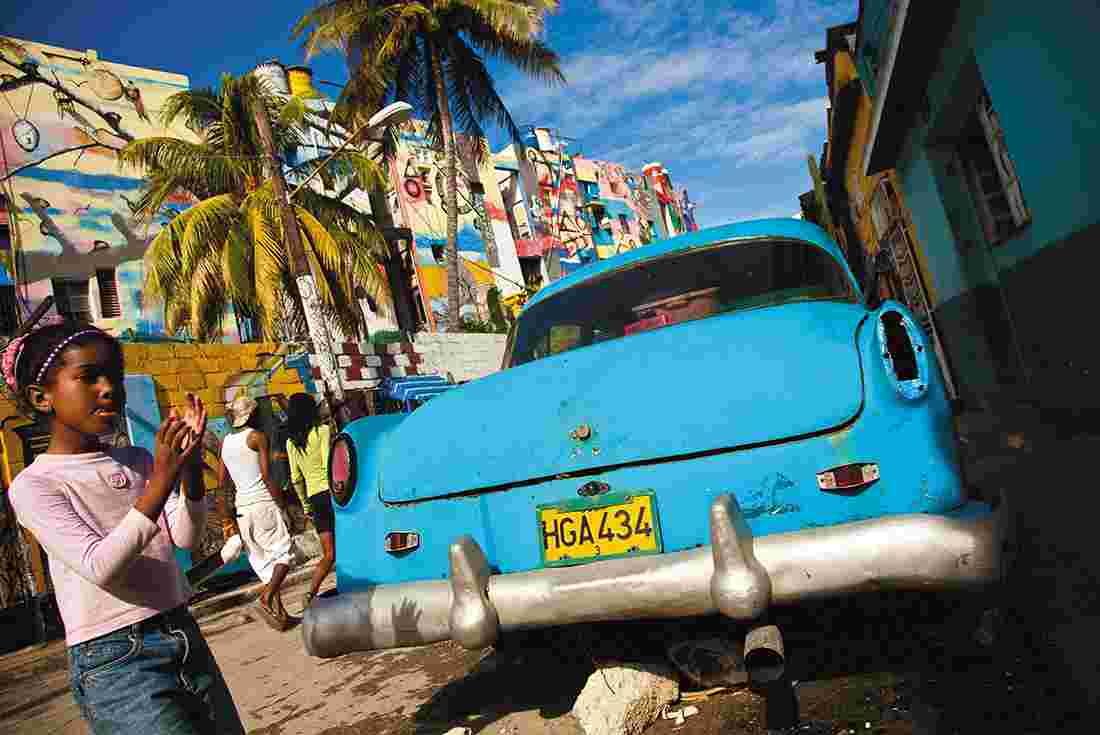 cuba havana blue car local girl palm trees