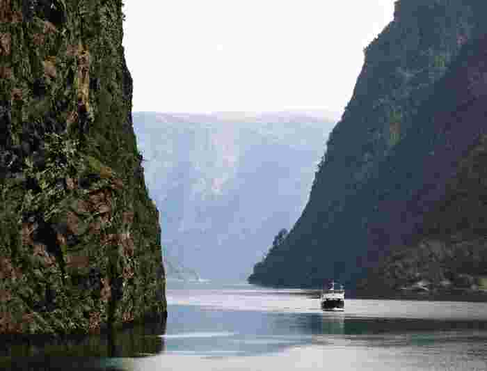 norway lone boat canyon cliffs river lake canal