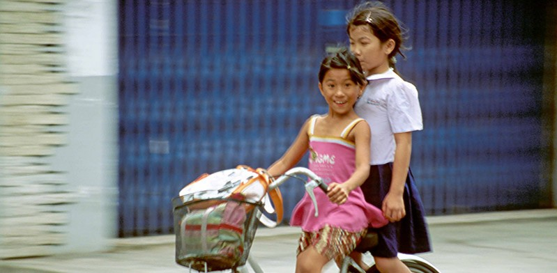 Girls cycling in Vietnam