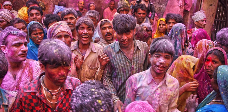 group of people covered in colours