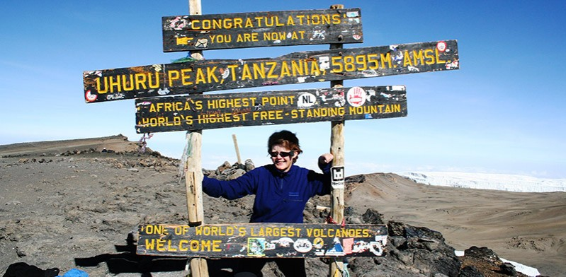 Jane Crouch at the summit of Mount Kilimanjaro Tanzania Africa