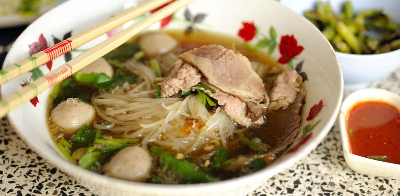 a bowl of vietnamese pho on a table
