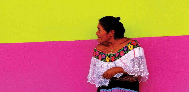 mexican lady standing against a wall