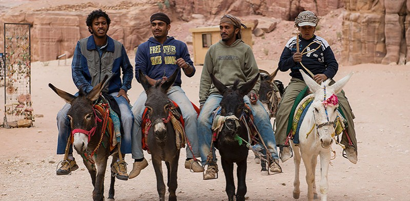 Locals riding donkeys in Jordan photo by Steve Davey