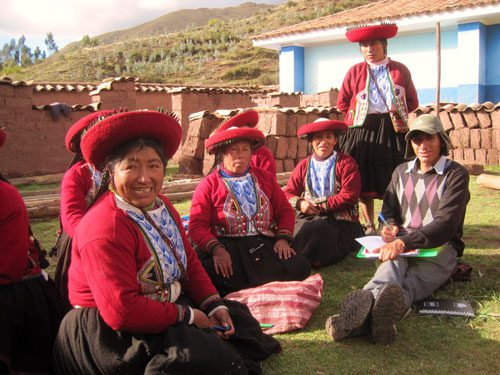 inca community sitting in a circle on the ground