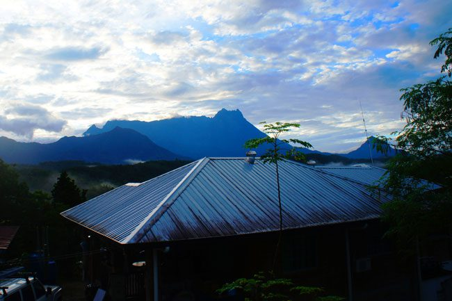 view of roof and mountain